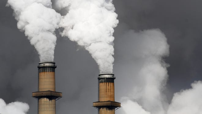 Steam billows from the stacks of the San Juan Generating Station, Wednesday, Jan. 13, 2016, as seen from the San Juan Mine in Waterflow