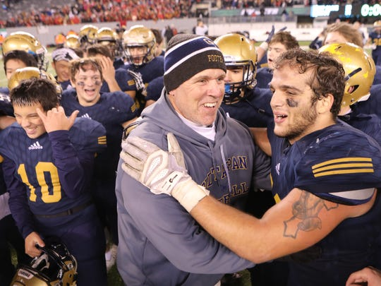 NV/Old Tappan Head Coach, Brian Dunn celebrates with Michael Mancuso after winning the NJSIAA North I Group IV Football Championship in East Rutherford, Sunday, December 2, 2017.