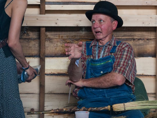 Broom maker George Jones, Jr., makes brooms and chats