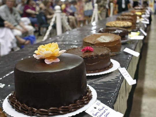Chocolate cakes await the scrutiny of the judge during