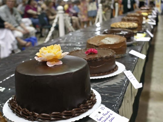 Chocolate cakes await the scrutiny of the judge during the 52nd annual Gerry Frank Chocolate Layer Cake Contest at the Oregon State Fair in 2011.