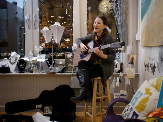 "Singer-songwriter Debbie Walton of East Lansing performs at Katalyst Gallery in Old Town March 3, 2017 during ""Arts Night Out."""