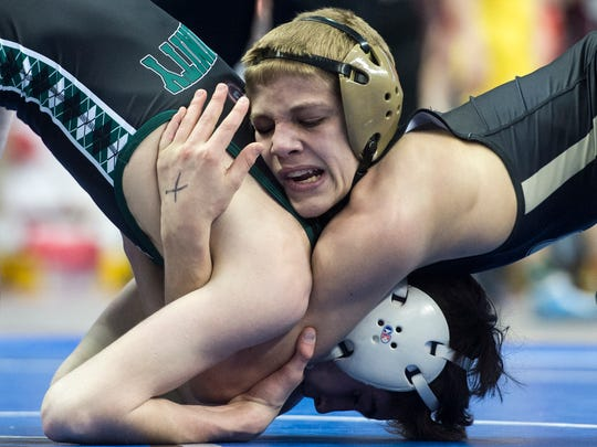 Biglerville's Blake Showers, right, wrestles Trinity's