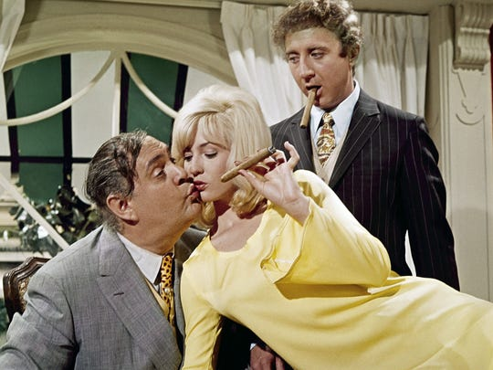"""Zero Mostel (left) and Gene Wilder (right) """"entertain"""" Lee Meredith in a scene from """"The Producers,"""" in theaters for a 50th anniversary showing."""