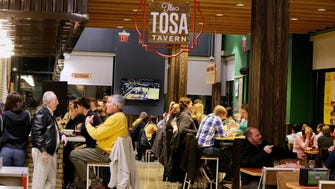 Tosa Tavern, the bar in the Wauwatosa Whole Foods store, draws a full house for Trivia Night each Thursday. The bar is also open daily for shoppers.