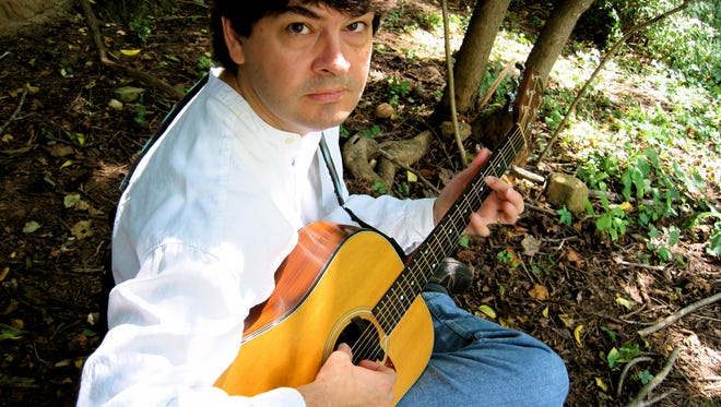 Consumate musician Chris Rosser plays in a number of bands in Asheville.