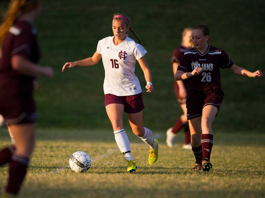 Henderson County's Katie Bickers (16) keeps the ball away from Webster County's Marissa Austin (26) during the Sixth District championship game at Union County High School in Morganfield,  Tuesday, Oct. 11, 2016. Henderson County beat Webster County 11-1.