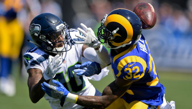 Rams cornerback Troy Hill (32), a St. Bonaventure High graduate, breaks up a pass intended for Seahawks receiver Paul Richardson during Sunday's game at the Coliseum,
