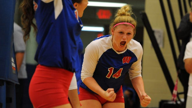 West Henderson and Taylor Houck (14) were defeated in Saturday's NCHSAA 3-A championship volleyball match by Cardinal Gibbons.