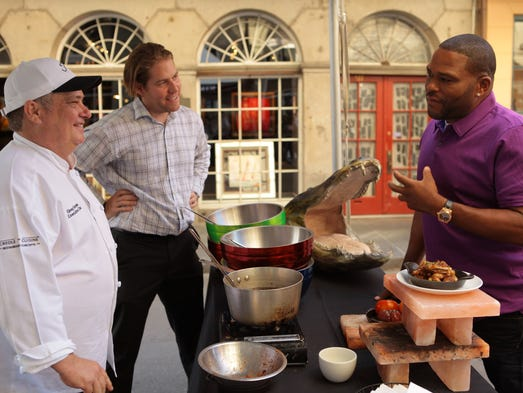 Food Network star Anthony Anderson speaks with guests Greg Sonnier and Trent Verges at the New Orleans Wine and Food Experience.