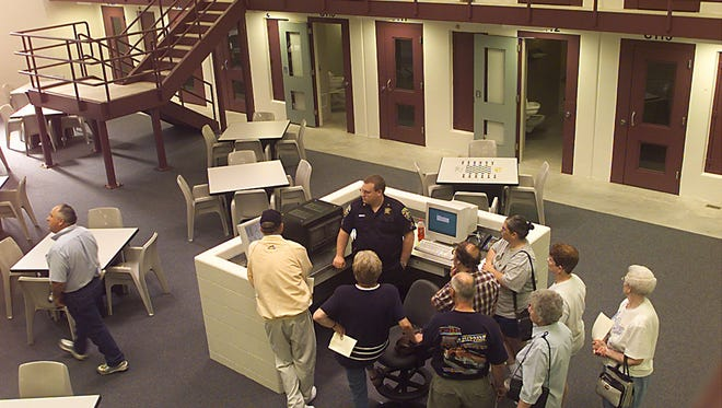 People tour the new Brown County Jail and Juvenile Detention Center during an open house in June 2001.