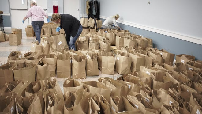 Hundreds of bags of food items were packed for distribution by staff members at the MLK Food Pantry March.