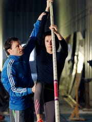 Jenn Suhr, a three-time Olympic pole vaulter, works with her coach/husband Rick Suhr in their training facility at their Riga home.