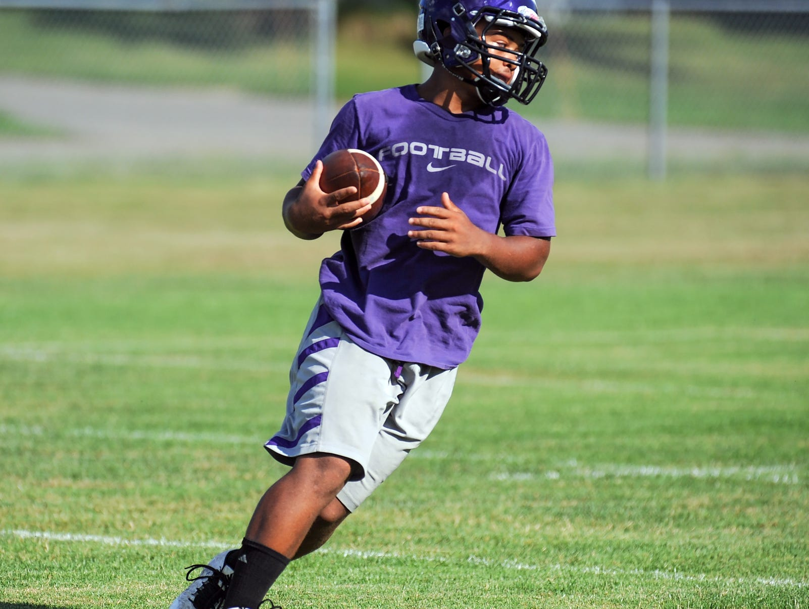 Lakeview's CJ Foster runs drills Tuesday night during the Spartan summer drill.