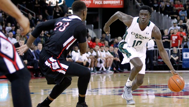 CSU's Joe De Ciman brings the ball up the court Wednesday night against Fresno State's Marvelle Harris in game in Fresno, Calif. De Ciman, one of four CSU seniors who will play his final home game at Moby Arena on Saturday, has won more games as a Ram than any player in school history.