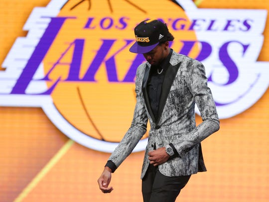 Jun 23, 2016; New York, NY, USA; Brandon Ingram (Duke) walks off stage after being selected as the number two overall pick to the Los Angeles Lakers in the first round of the 2016 NBA Draft at Barclays Center. Mandatory Credit: Brad Penner-USA TODAY Sports ORG XMIT: USATSI-269318 ORIG FILE ID: 20160623_jel_ae5_032.jpg