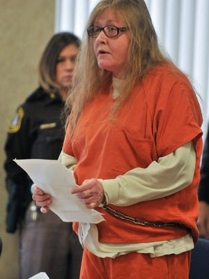 Judy Higley-Zuehlke reads a statement to Judge Michael West shortly before her sentencing Thursday morning in 31st Circuit Court in Port Huron. She was convicted in October of second-degree murder in the death of her former boyfriend, John Allen. The 44-year-old woman also was convicted of lying to a peace officer during a violent crime investigation, concealing the death of an individual, and tampering with evidence.