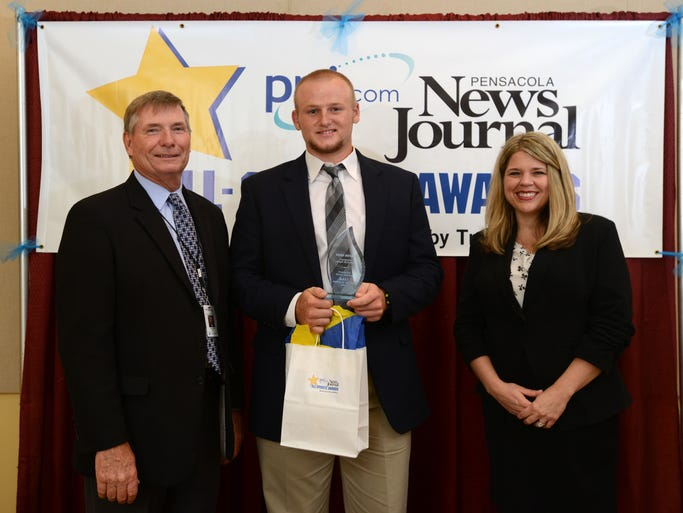 Catholic High School's Cody Henry is named Male Athlete of the Year on Thursday during the Pensacola News Journal All-Sports Award Banquet sponsored by Troy Rafferty. Publisher Terry Horne and Kim Adams, representing Rafferty, present the award.