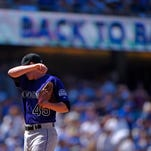 Colorado Rockies relief pitcher Scott Oberg wipes his face after giving up back-to-back home runs to Los Angeles Dodgers' Scott Van Slyke and Joc Pederson during the fifth inning of a baseball game Sunday in Los Angeles.