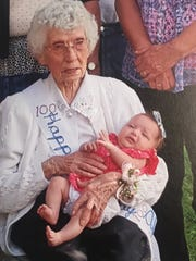 Alys Arionus, who turned 100 in September, still volunteers for others, making crocheted blankets. At her party, she is holding her great-great-granddaughter.