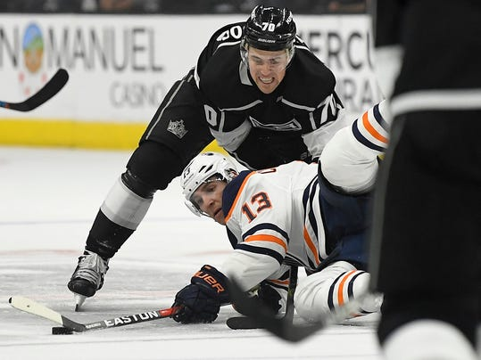 Edmonton Oilers left wing Michael Cammalleri, below, falls as he tries to pass the puck while under pressure from Los Angeles Kings left wing Tanner Pearson during the first period of an NHL hockey game, Wednesday, Feb. 7, 2018, in Los Angeles. (AP Photo/Mark J. Terrill)