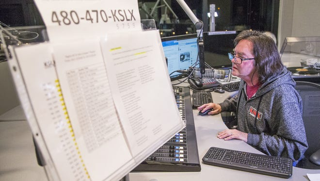 KSLX radio personality Russ Egan works during his show at the station in Phoenix.