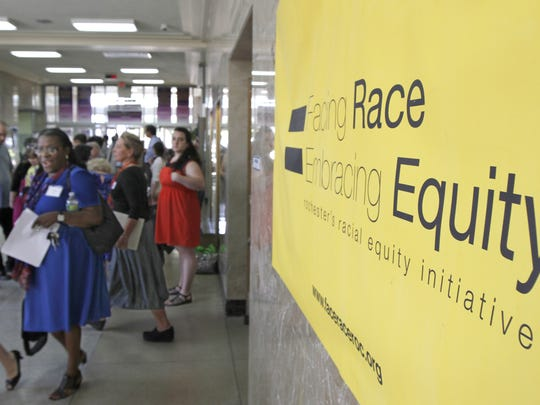 Attendees head to five breakout session at the Facing Race = Embracing Equity Community Summit on Race held May 30, 2013, at East High in Rochester.