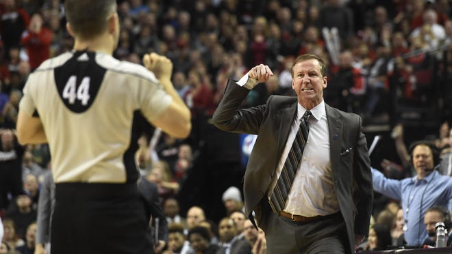 Portland Trail Blazers head coach Terry Stotts is called for a technical foul as he argues a call by referee Eli Roe (44) during the fourth quarter of an NBA basketball game against the Utah Jazz in Portland, Ore., Sunday, Feb. 21, 2016. The Blazers won 115-111.(AP Photo/Steve Dykes)