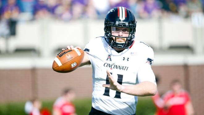 Cincinnati Bearcats quarterback Gunner Kiel (11) gets ready to throw the ball during the 1st quarter against the East Carolina Pirates at Dowdy-Ficklen Stadium.