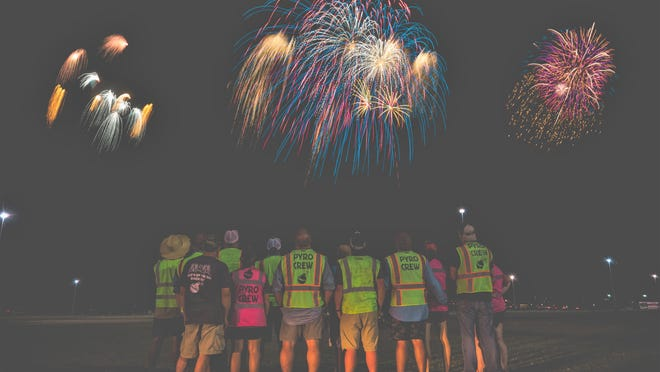 Brady Baskin, owner of Brady's Stockpile O' Fireworks, and his pyrotechnic crew watch the finale of the Choctaw Casino & Resort - Durant 2019 fireworks extravaganza. The company is once again orchestrating a display at the property that is scheduled for July 4.