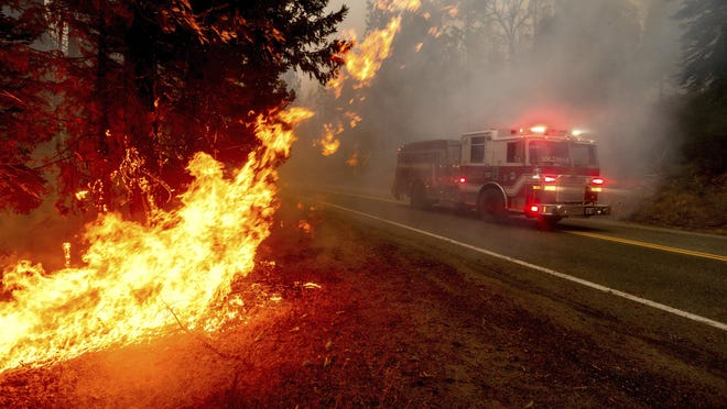 Firefighters respond to a wildfire in Fresno County, Calif., earlier this week. Texas is sending firefighters and vehicles to help the state fight multiple large-scale fires.
