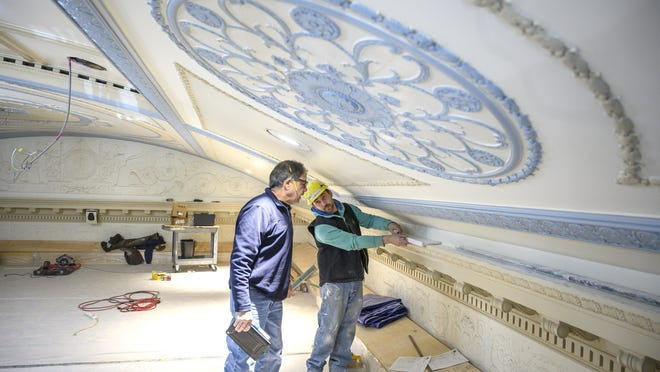 Farrar Associates construction superintendent Bob Murgo, left, talks with Ken Wildes Jr. about the decorative ornamental plaster work Wildes is working on with his father, Ken Wildes Sr., as part of the renovations at BankNewport in January. The bank on Washington Square will be recognized during the 2020 Doris Duke Historic Preservation Awards in September.