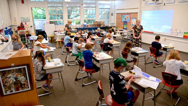 Desks are arranged to keep students socially distanced in the classrooms at Shore Country Day School in Beverly.