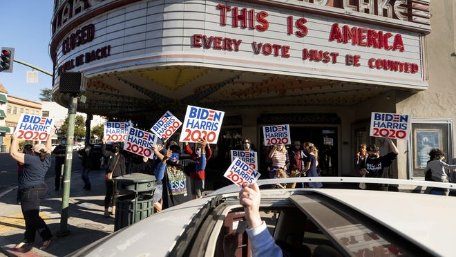 People celebrate the victory of President-elect Joe Biden and Vice President-elect Kamala Harris in Oakland, Calif., on Saturday, Nov. 7, 2020.  Biden defeated President Donald Trump to become the 46th president of the United States on Saturday, positioning himself to lead a nation gripped by the historic pandemic and a confluence of economic and social turmoil.