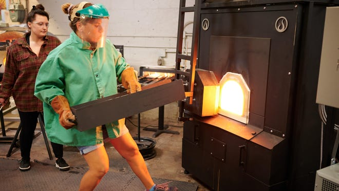 Jeremie Draper fires up her brand new glass melting furnace, which was delivered the day Gov. JB Pritzker announced the COVID-19 shutdown.