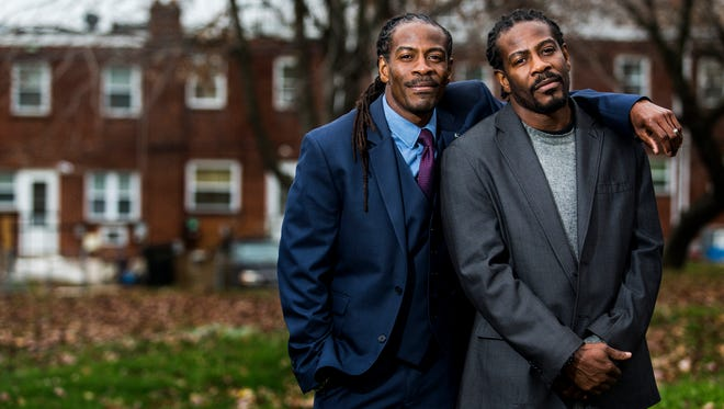Wilmington City Councilman Nnamdi Chukwuocha (left) and his identical twin brother Al Mills pose for a portrait near 35th and N. Church St. in Wilmington on Wednesday afternoon. The brothers have been named the state's seventeenth poet laureates.