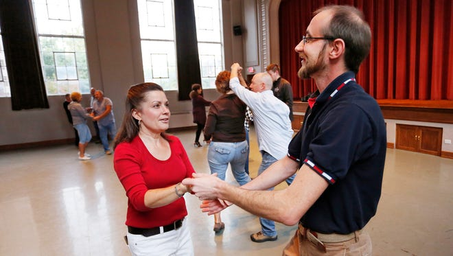 Cheryl Crabill and Charles Lewis V take part in the dance class Tuesday, September 12, 2017, at the Morton Community Center.