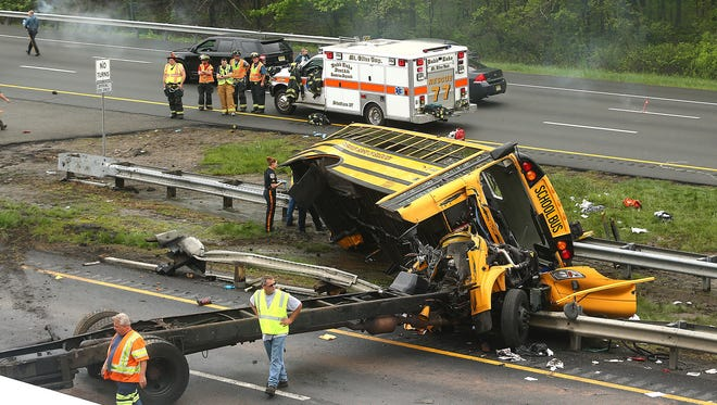 A school bus carrying middle school students from Paramus, N.J., was ripped from its chassis in an accident with a dump truck on Route 80 in Mount Olive, N.J., on Thursday, May 17, 2018.