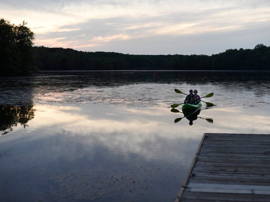 Wendy Huffman and Earl Harvester paddle back to shore
