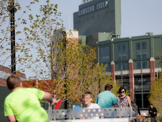 People play ping pong in the Titletown District on