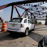 """Cars drive on the 130th St. bridge over the Little Calumet River in Chicago on Sept. 11, 2013. It was classified as both """"structurally deficient"""" and """"fracture critical"""" in federal data for 2012."""