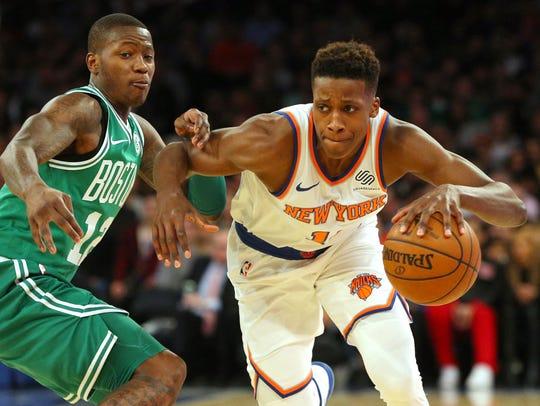 New York Knicks point guard Frank Ntilikina (11) controls