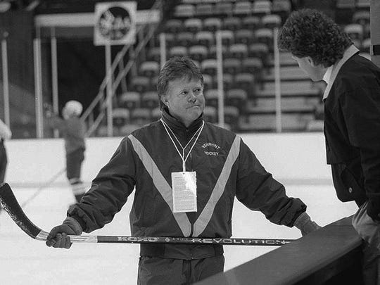 UVM hockey coach Mike Gilligan chats amiably with Colorado