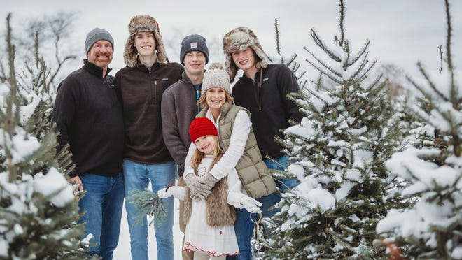 From left, Jim Shikenjanski with his sons, Sam, a senior at Stillwater Area High School, and Max, a sophomore at Stillwater, daughter, Ava, a second-grader at St. Croix Prepatory Academy and wife, Rebecca.
