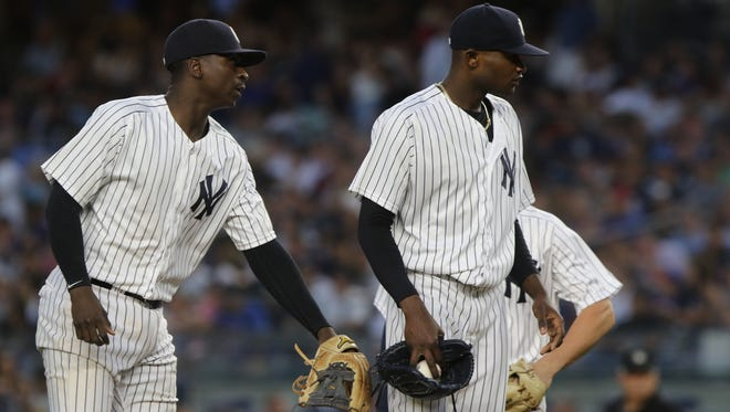 Yankee shortstop Didi Gregorius, left, encourages starting pitcher Domingo German as he was being taken out of the game against the Mets in the fourth inning on Friday, July 20, 2018 at Yankee Stadium.