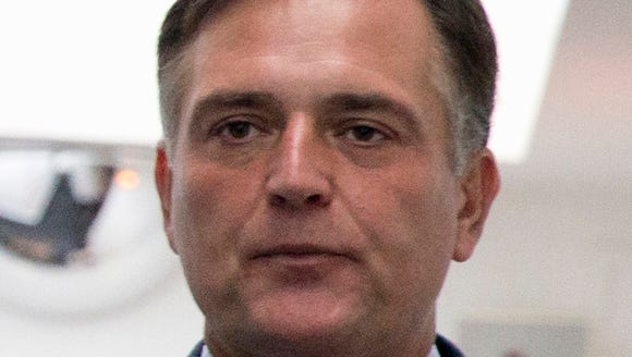 Rep. Luke Messer, R-Ind., leaves a caucus meeting on