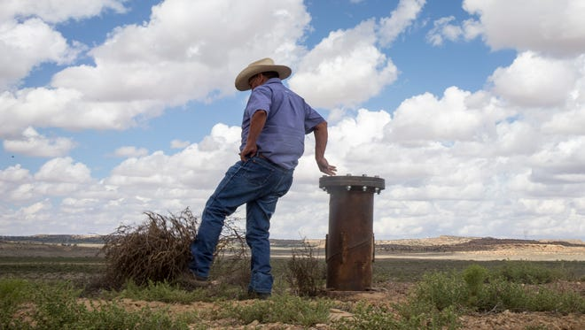 Max Taylor of Hopi Water Resources checks out a  new Hopi Arsenic Mitigation Project (HAMP)  wellhead located about 15 miles north of the Hopi Cultural Center.