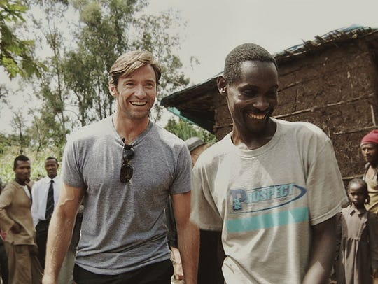 Hugh Jackman and coffee farmer Dukale, in a scene from