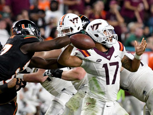 Miami Hurricanes defensive lineman Jonathan Garvin (97) causes a fumble from Virginia Tech Hokies quarterback Josh Jackson (17) during the second half at Hard Rock Stadium.