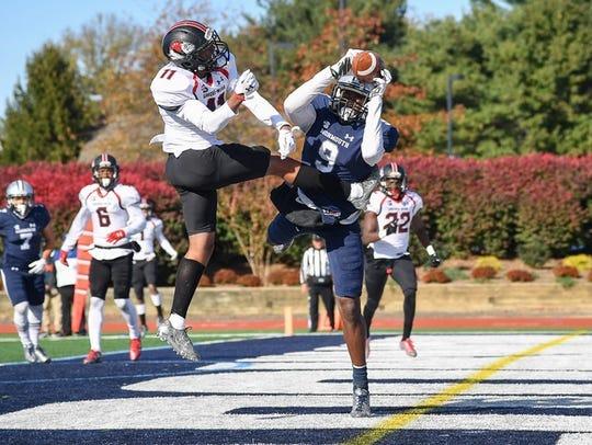Monmouth's Reggie White Jr. makes a leaping touchdown